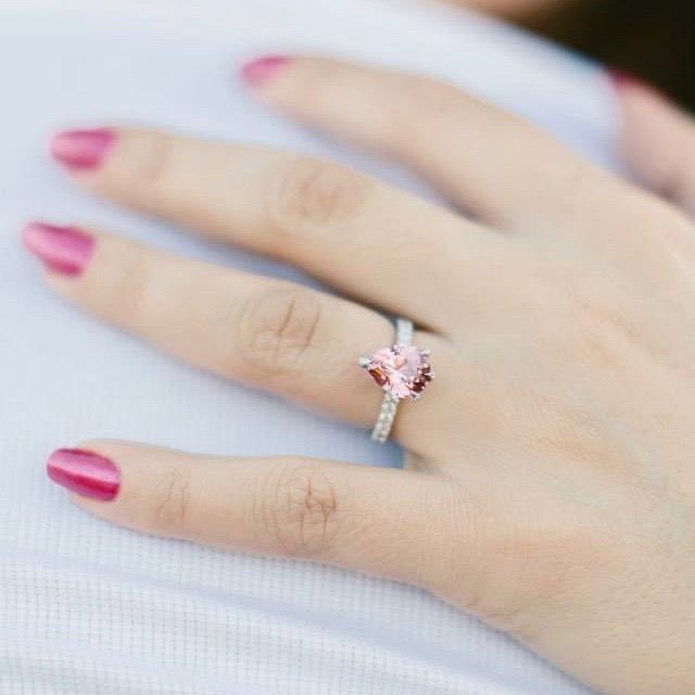Pink spinel with diamond set claws engagement ring