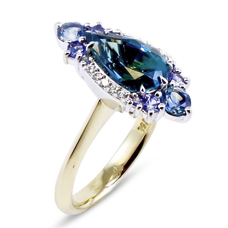 Teal tourmaline, sapphire and diamond ring in two tone gold