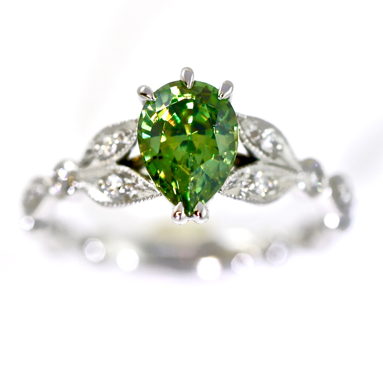 Green demantoid garnet and diamond anniversary ring in platinum