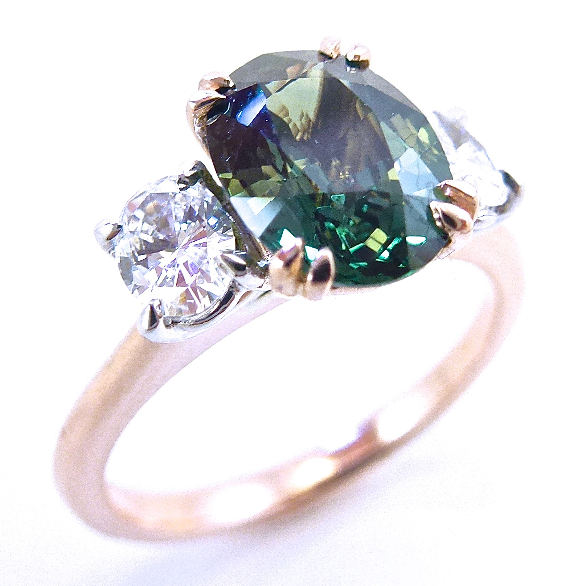 Green sapphire and diamond trilogy ring in rose and white gold