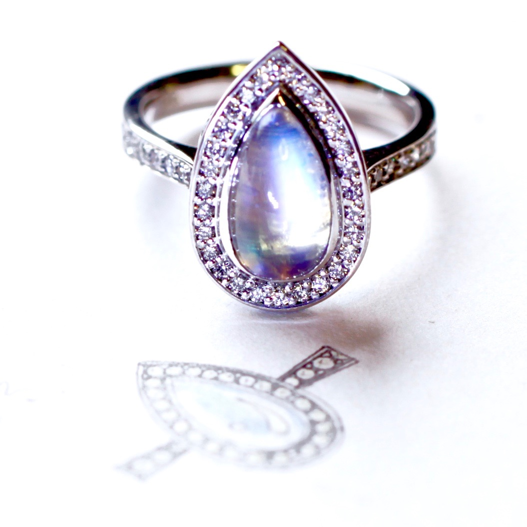 Moonstone and diamond halo engagement ring