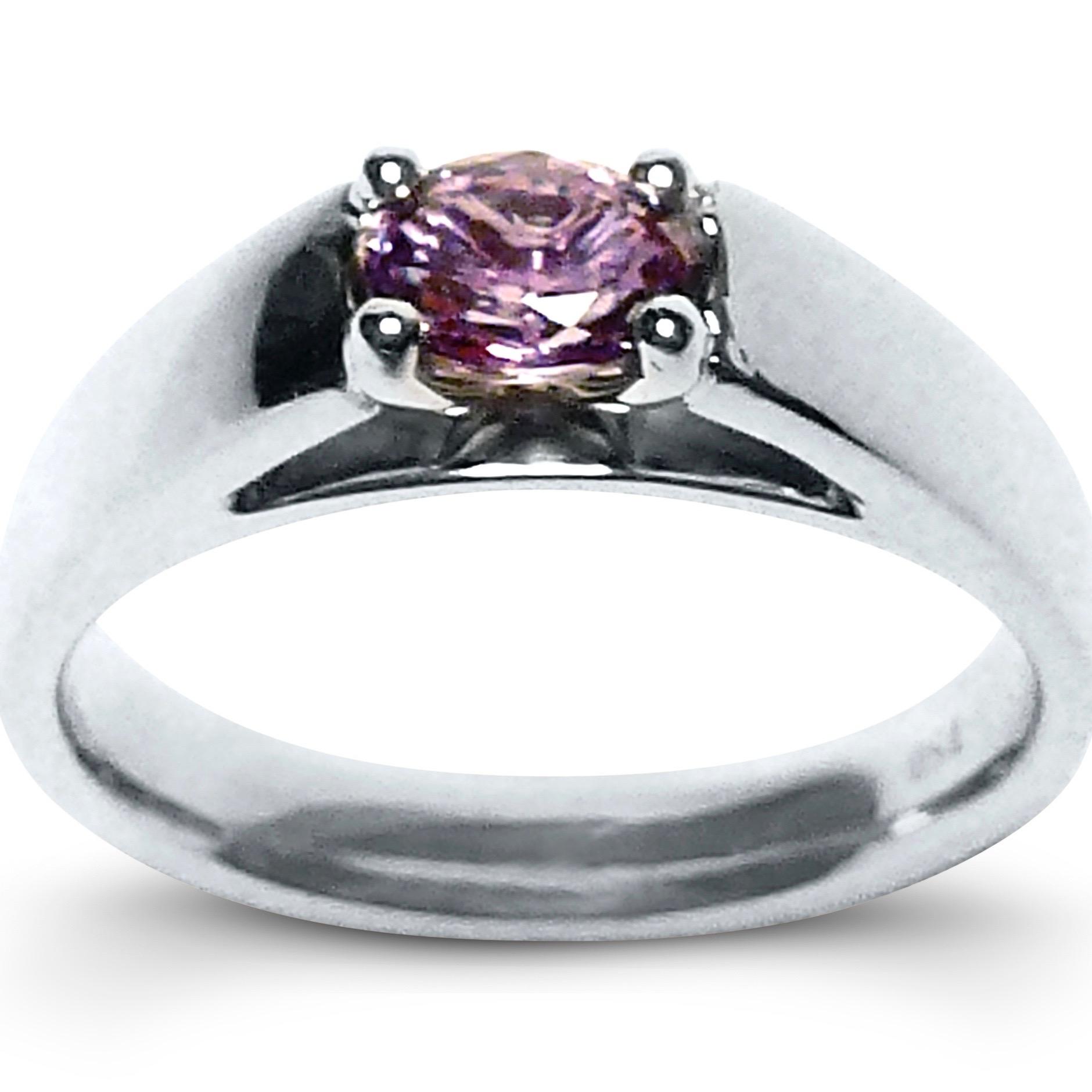 Natural colour change alexandrite engagement ring