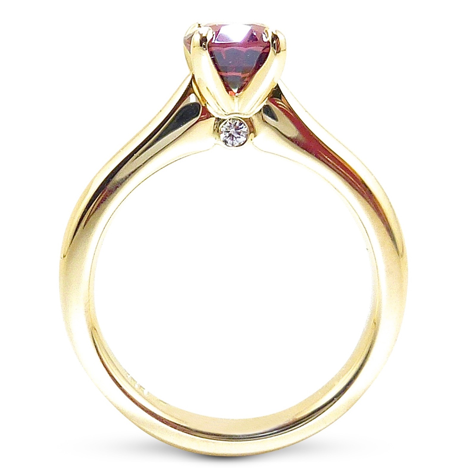 Red spinel and hidden diamond engagement ring