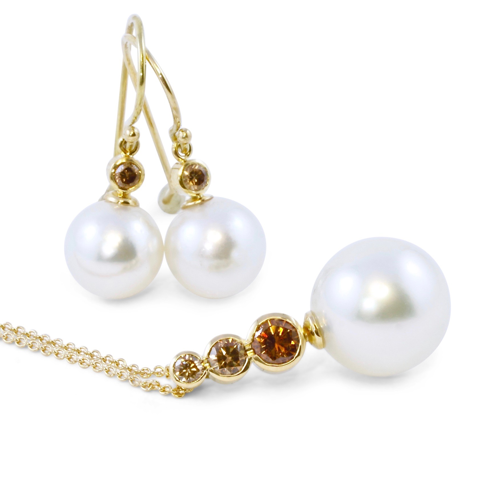 South sea pearl and champagne diamond earrings and pendant